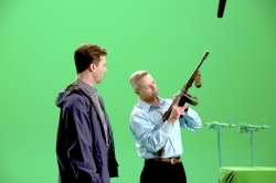 Decker reviews the open-safe configuration of a Thompson submachine gun with Golden Globe actor Jon Hamm